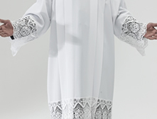 "White polyester square neck surplice with 9"" IHS lace on sleeves and bottom"